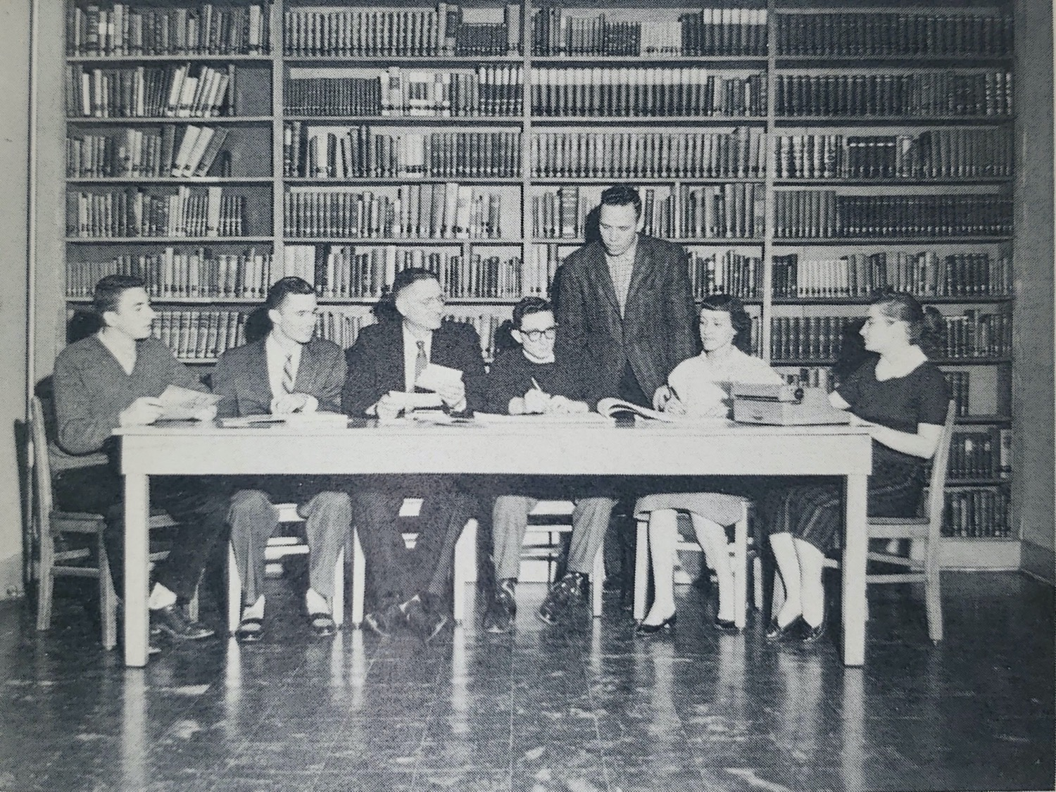 People in library sitting at table